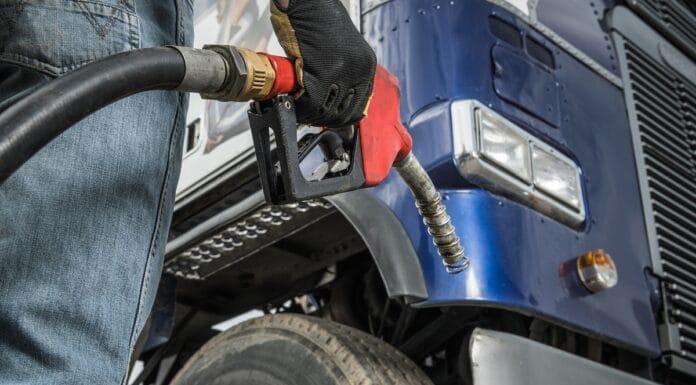Trucker in Front of His Truck Preparing For Diesel Fueling